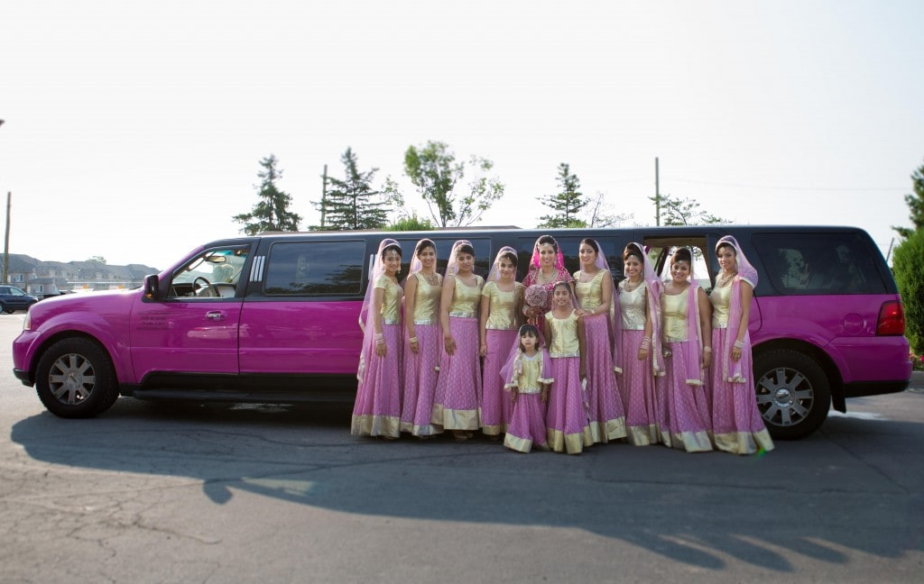 A pink fairy tale wedding is only complete with a pink limo.