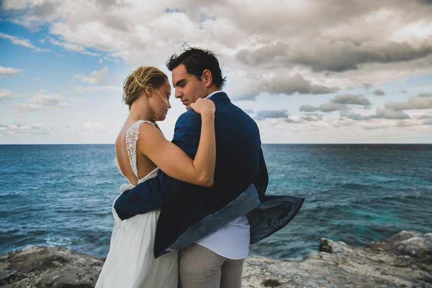Newlyweds overlooking the Caribbean Sea.