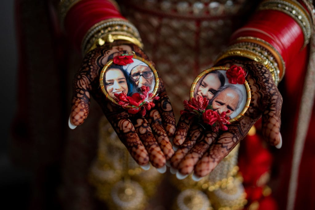 Henna hands with images of her grandparents
