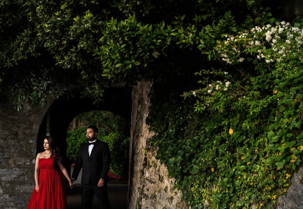 Engagement photo session in Lake Como. Bride in extra long flowy red dress.