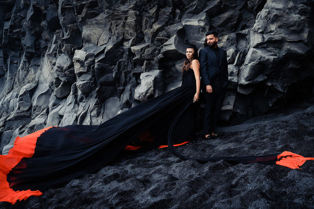 Couple photoshoot at Black beach with black rocks in Iceland