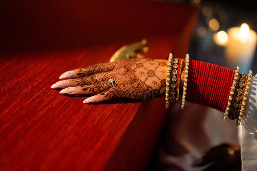 Henna hand over Sabyasachi outfit box