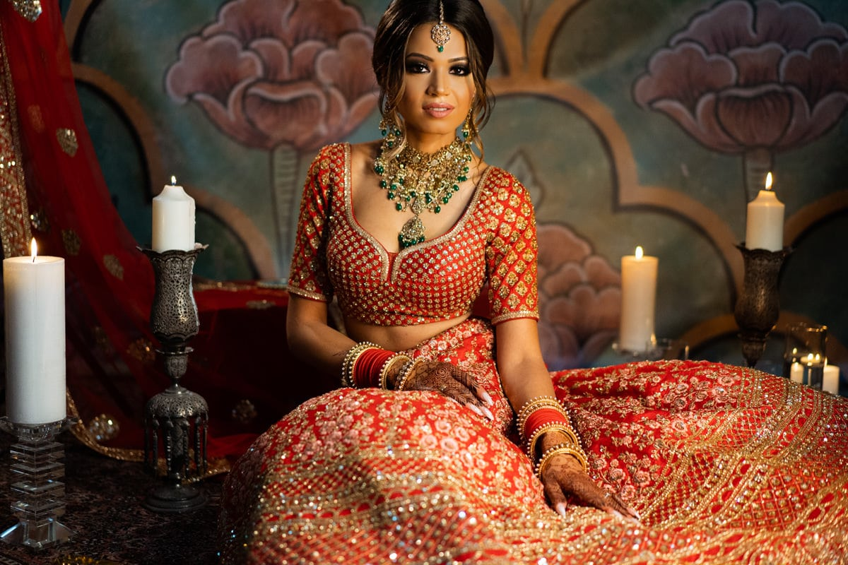 Indian bride in red Sabyasachi lehenga