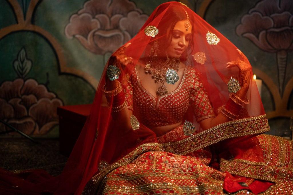 Indian bride in red Sabyasachi lehenga