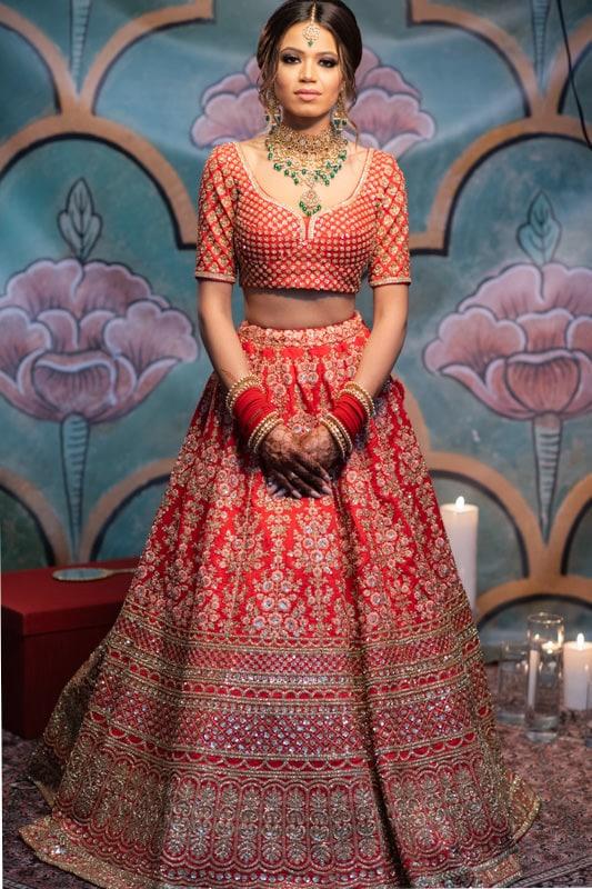 Indian bride in red Sabyasachi lehenga full length