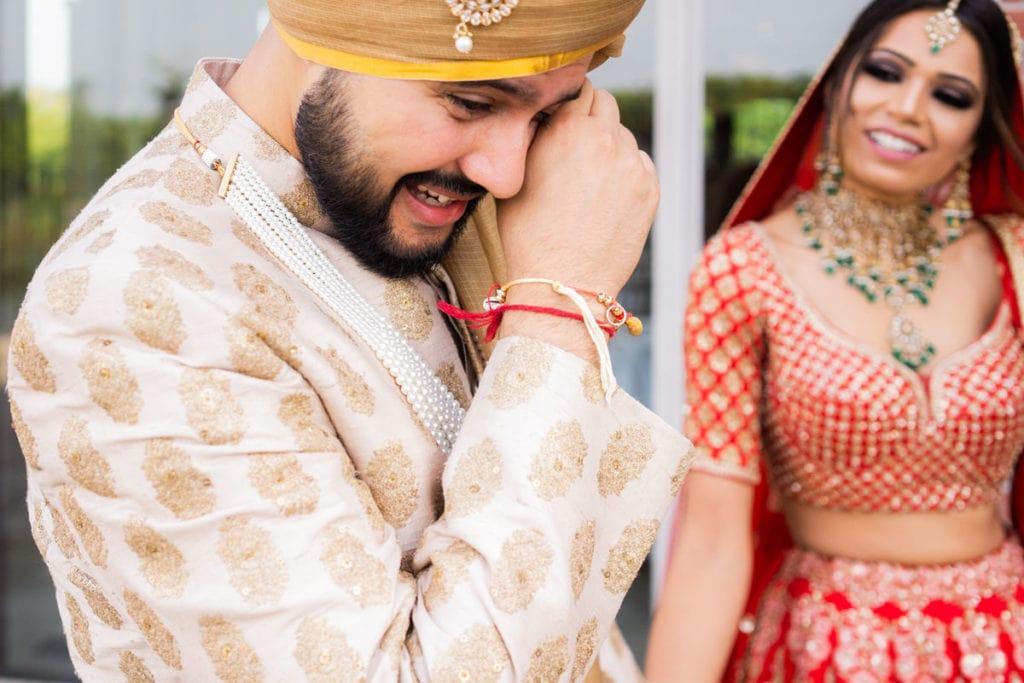First look - groom wipes tears of joy
