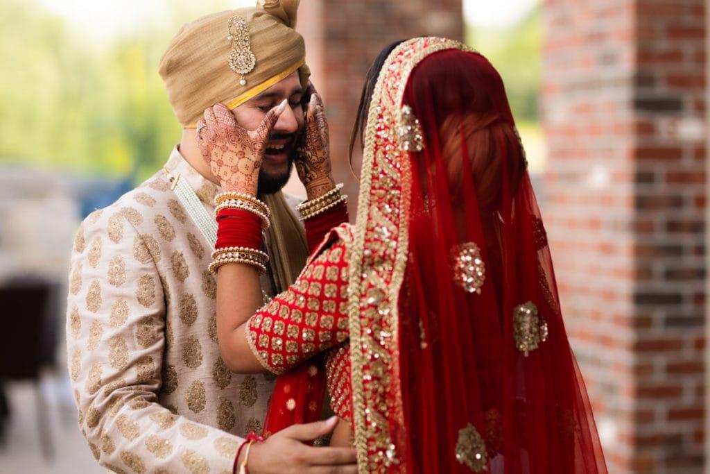 First look - bride wipes groom tears of joy