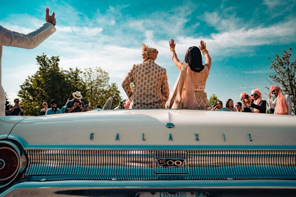 Groom makes his entrance with best friend in a vintage car