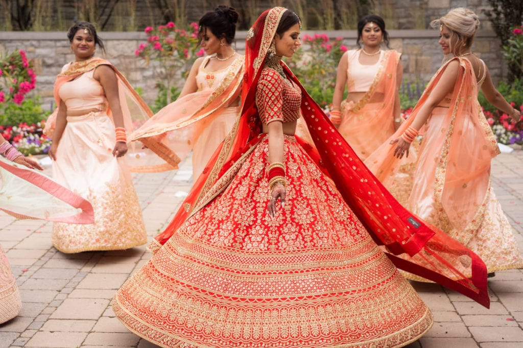 Bride and bridesmaids twirl in their lehengas