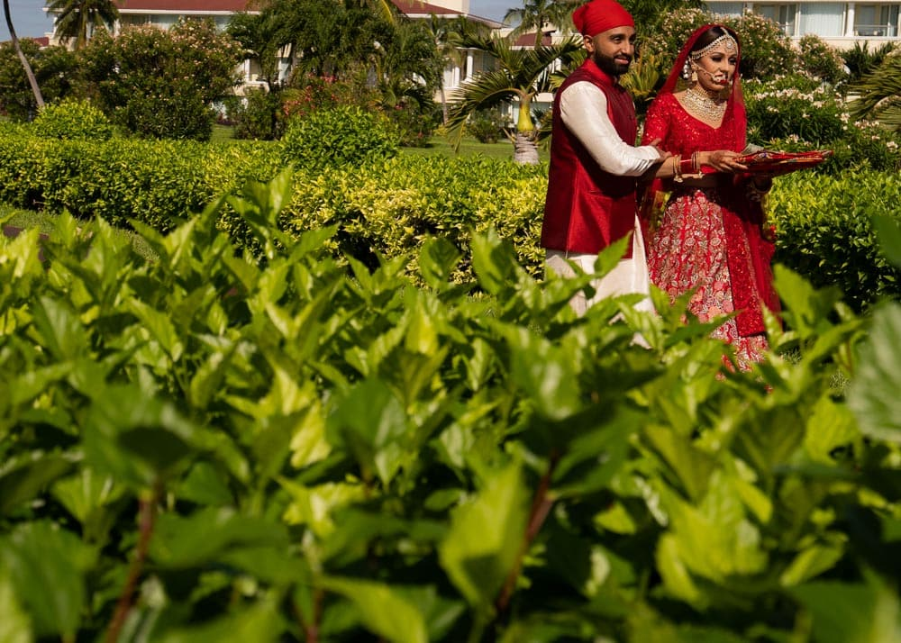 Moon Palace Sikh Hindu Indian Wedding in Cancun Mexico. Indian Bride in Red with brother.