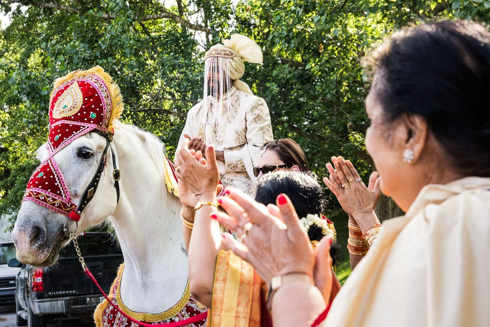 Baraat at this floral outdoor Indian Wedding