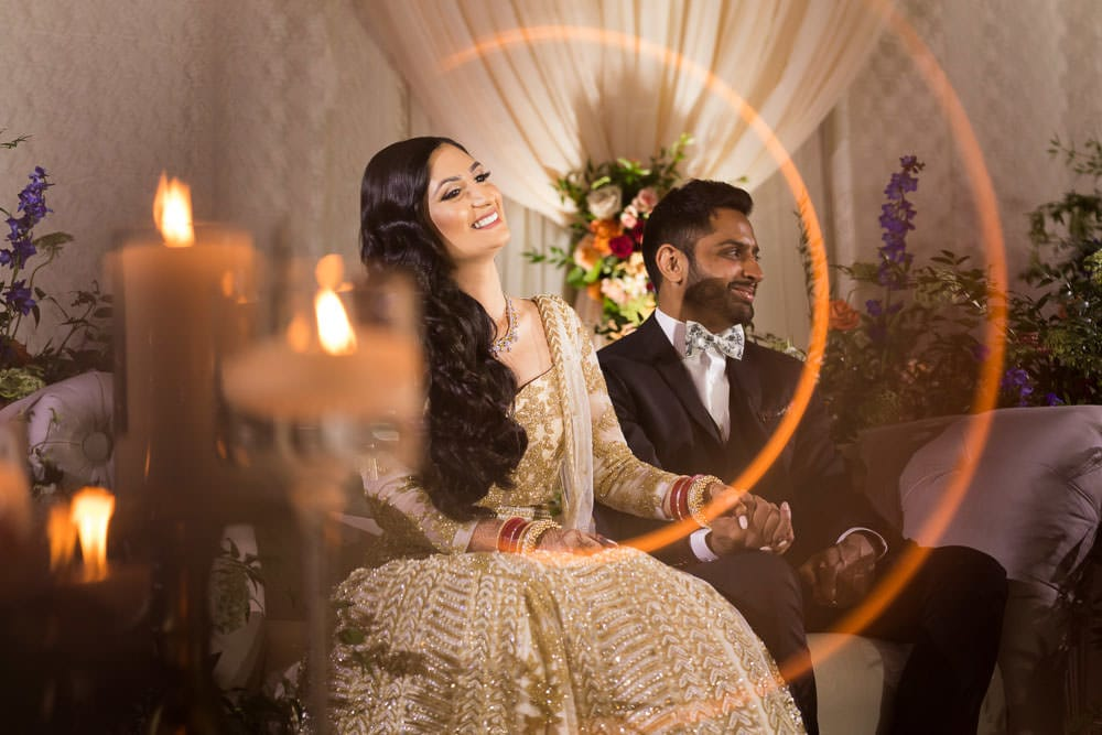 Indian Bride and Groom at their floral Indian wedding reception at The Ritz-Carlton Toronto