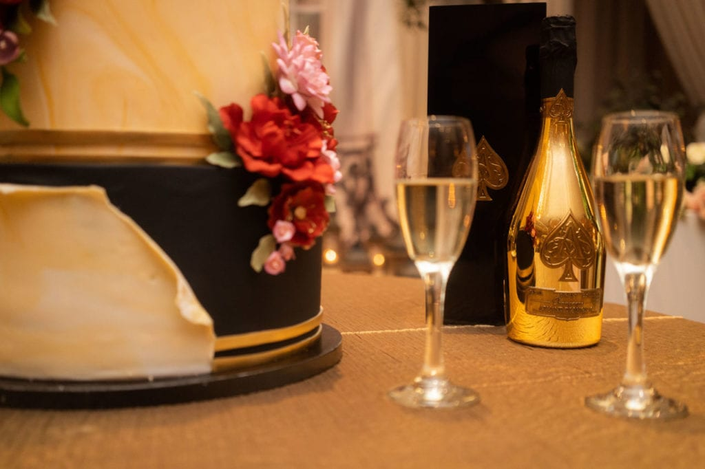 Cake and Ace of Spade champagne for Indian wedding at Bellvue Manor, Toronto.