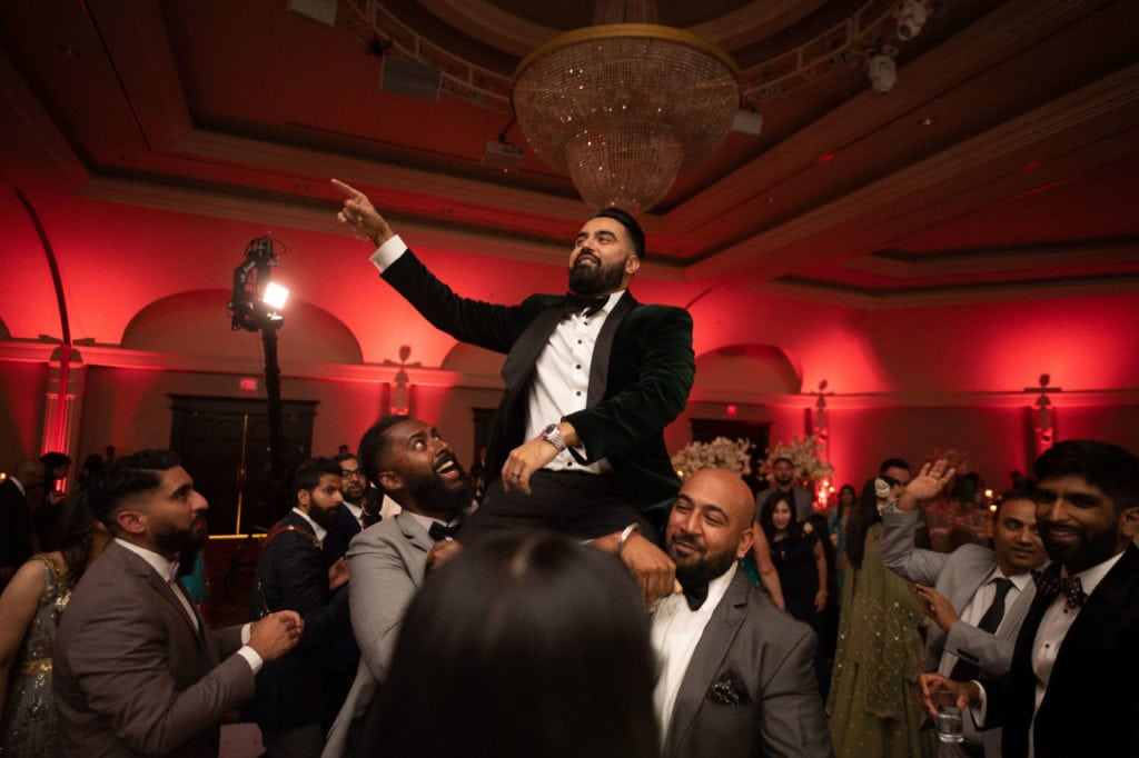 Modern Indian couple at their glamorous reception at the Bellvue Manor, Toronto. Groom dancing the night away.