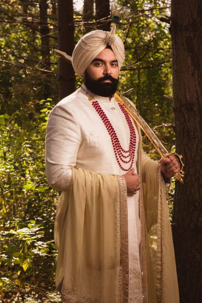 Anita Dongre groom in off-white Indian sherwani.