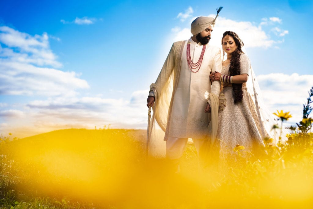 Anita Dongre bride and groom in off-white Indian outfits. Outdoor post-ceremony photoshoot in greater Toronto area.