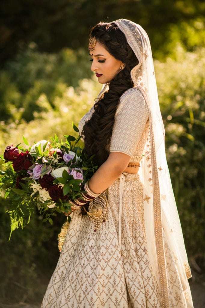 Anita Dongre bride in off-white Indian lengha.